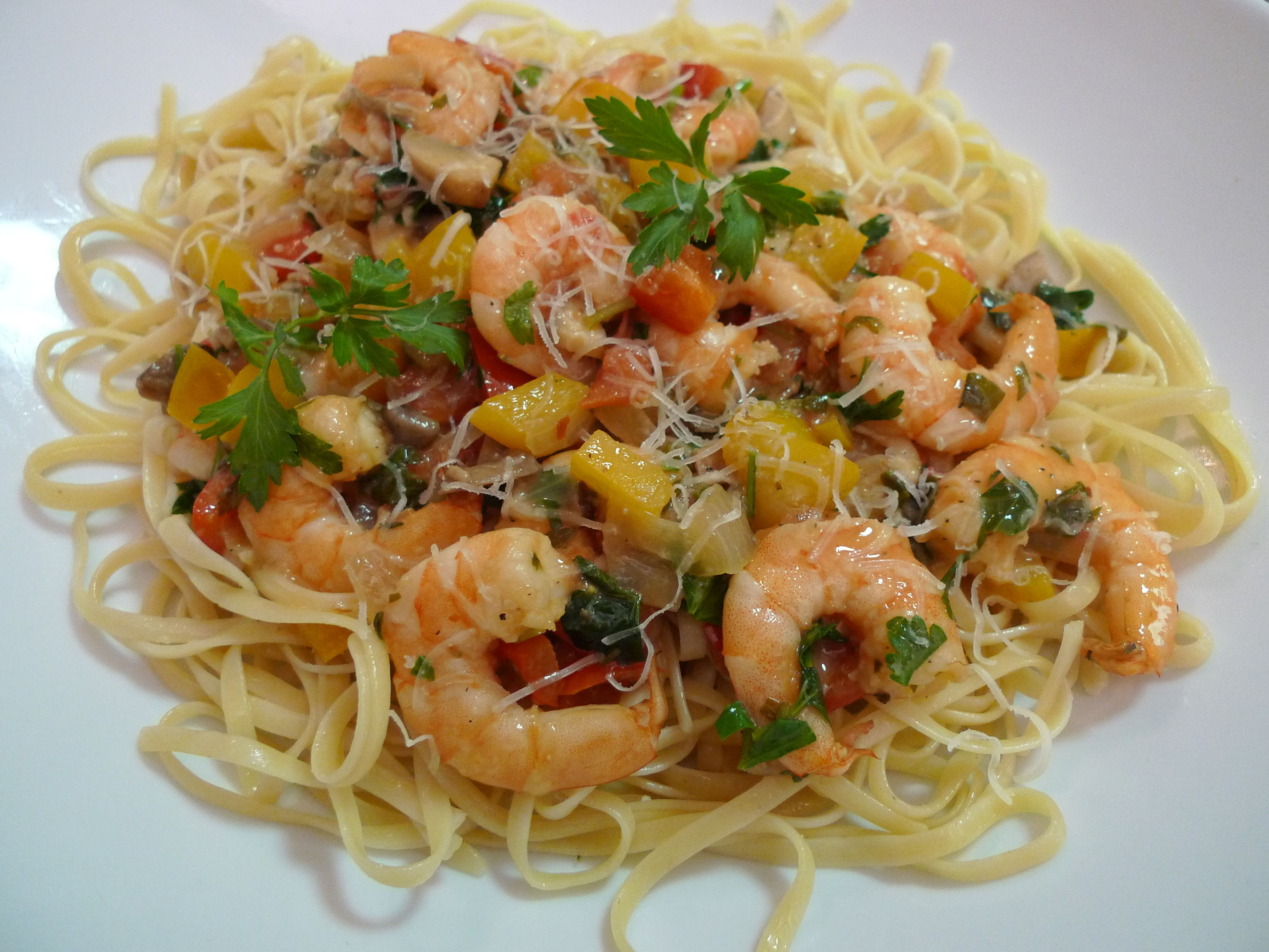 shrimp scampi topped with parsley and asiago cheese