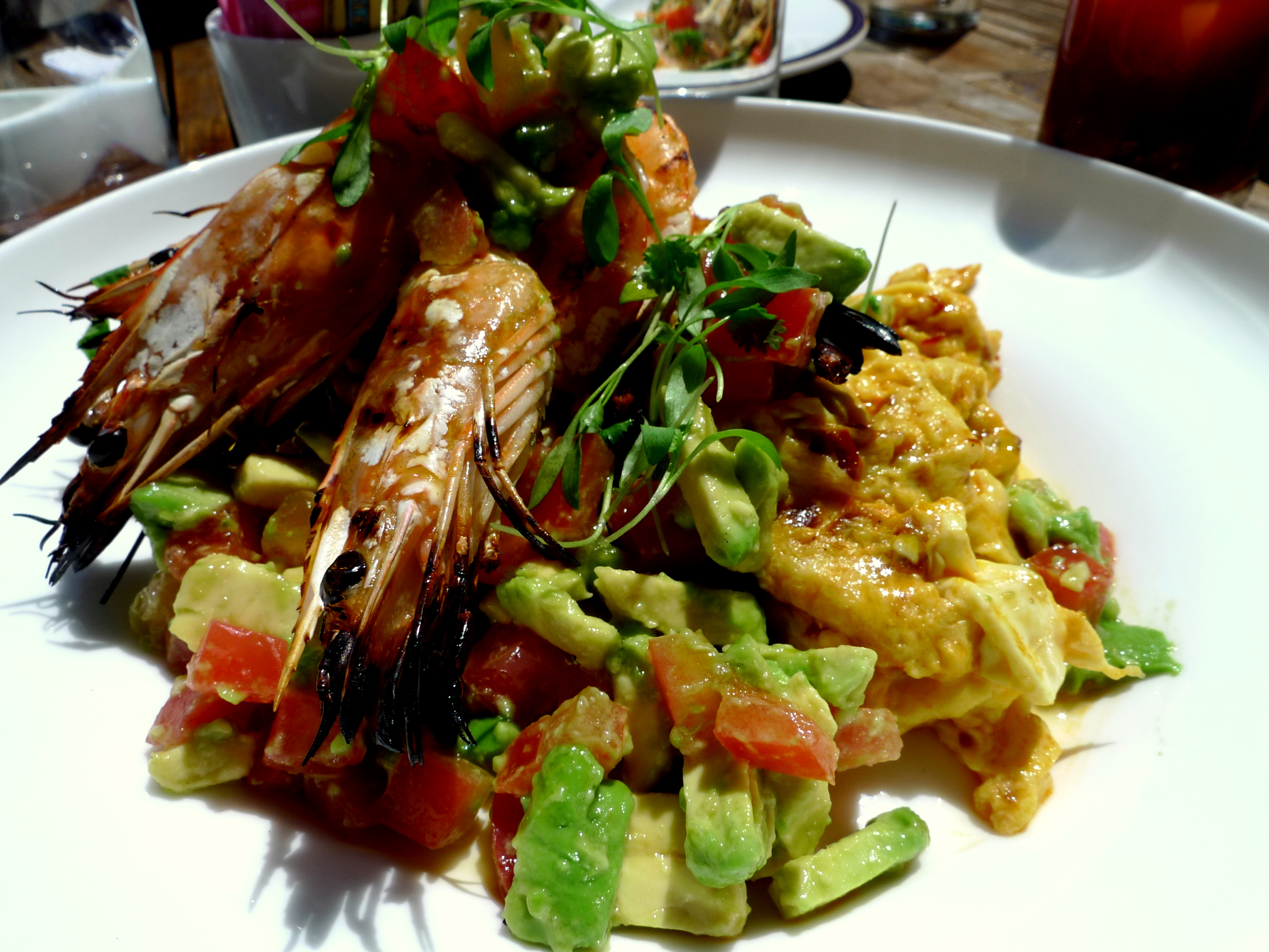 Grilled Sambal Prawns & Scrambled Eggs with avocado and tomato salad