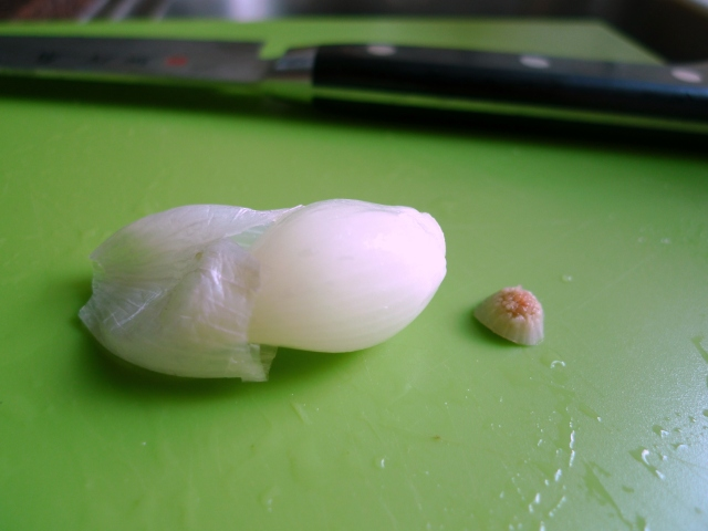squeeze the pearl onions from its outer skin