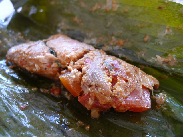 steamed fish in a banana leaf