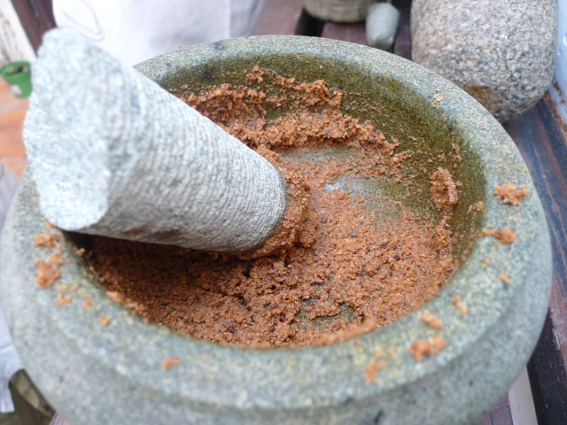 grinding the coconut into a paste