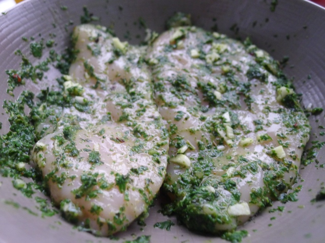 rub the chicken breasts in the pesto