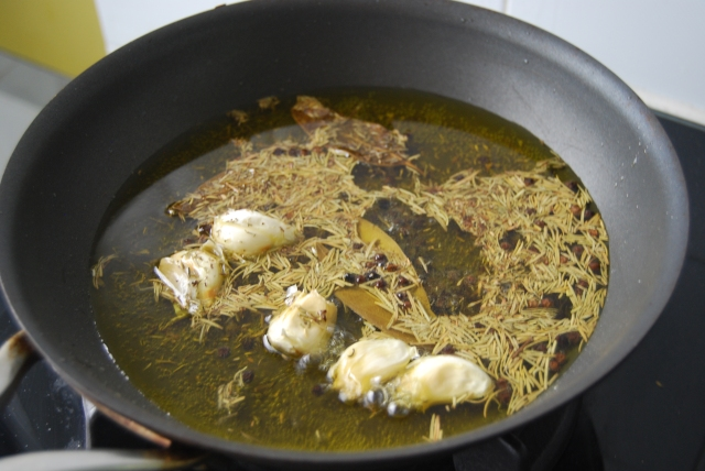 toast the herbs and garlic in olive oil