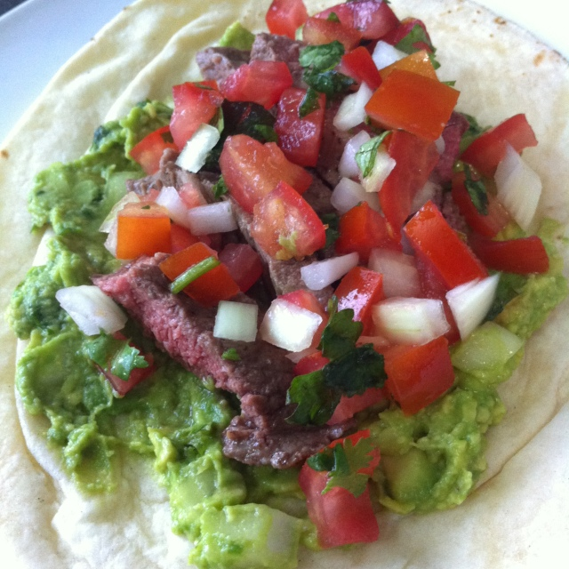 assemble the skirt steak with guacamole and pico de gallo