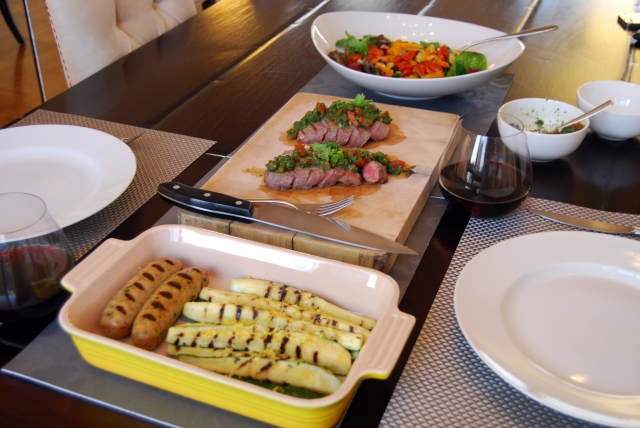 grilled zucchini, sausages, flank steak with salsa verde, and salad