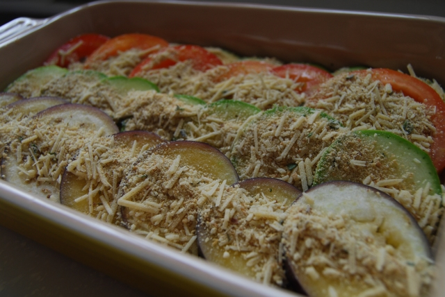 layer the veggie slices and sprinkle the bread crumb cheese mixture on top