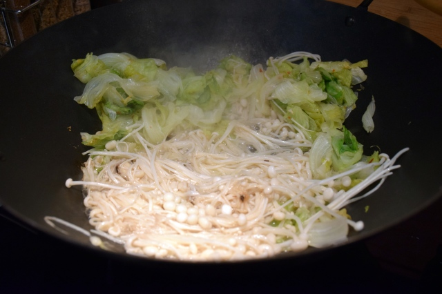 add in the enoki and cook until water has evaporated