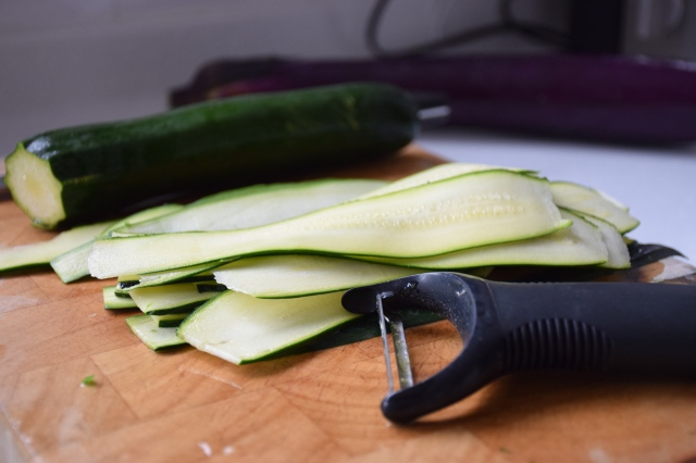 slice zucchini into ribbons with a vegetable peeler