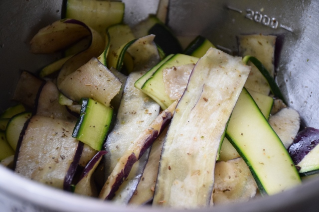 toss the vegetable slices with olive oil, salt, pepper, and dried herbs