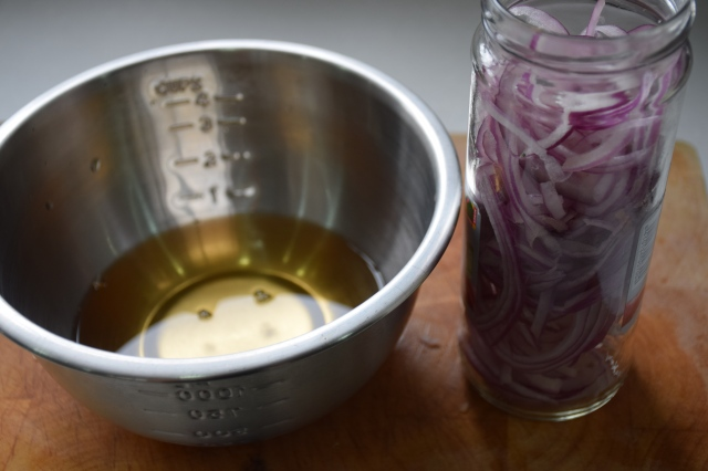 red onions pickled with apple cider vinegar mixture