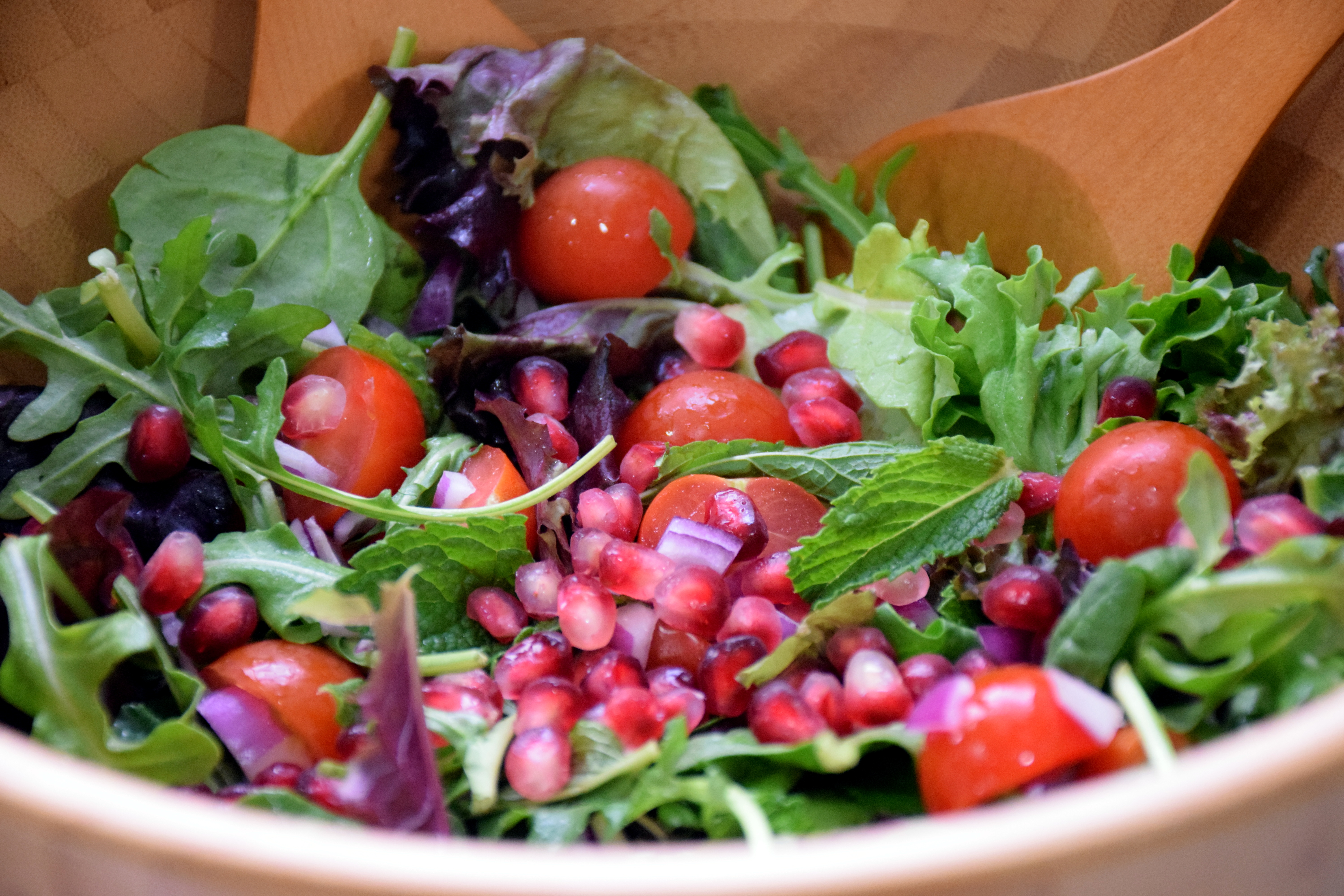 toss salad leaves, mint, cherry tomatoes, red onion and pomegranate ...