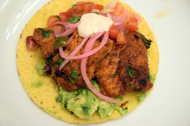 baked fish tacos with pickled red onions, guac, chili-lime sour cream