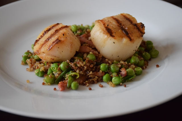 spoon the quinoa mix on a plate then top with scallops