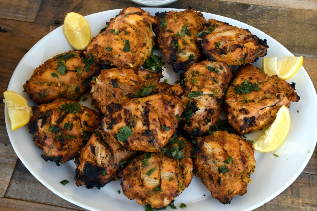 garnish chicken with lemon and cilantro